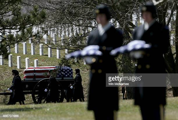 S Army honor guard escorts the caisson carrying a casket with the remains of eight airmen who were listed as missing in action during a burial...