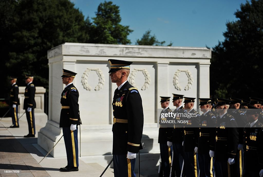 US Army Honor Guards take part in a wreath laying at the Tomb of Unknown Soldier in honor of the US Parks Police on September 18 2013 at Arlington...