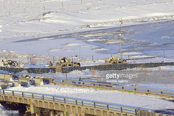 Army humvees blockades and razer wire block the end of the bridge at the Oceti Sakowin camp in Canon Ball North Dakota on December 4 2016 The US Army...