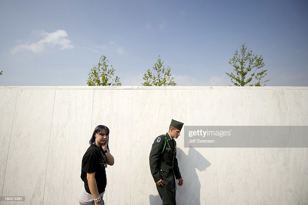 Army JROTC members Samantha Clark (L), 14, and Jesse Weaver, 19, from Uniontown, Pennsylvania walk past the names during ceremonies commemorating the 12th anniversary of the 9/11 attacks on September 11, 2013 in Shanksville, Pennsylvania. The nation is commemorating the anniversary of the 2001 attacks, which resulted in the deaths of nearly 3,000 people after two hijacked planes crashed into the World Trade Center, one into the Pentagon in Arlington, Virginia and one crash landed in Shanksville, Pennsylvania.