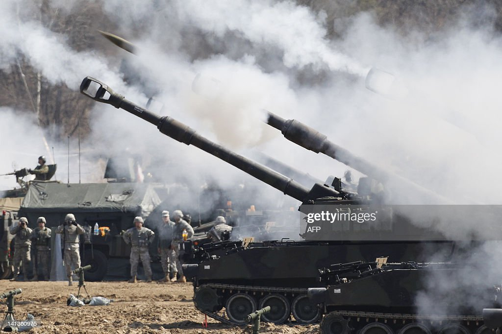 US Army M109A6 Paladin selfpropelled howitzers of the Second Infantry Division of the US Forces Korea attend a live firing drill at the US army's...