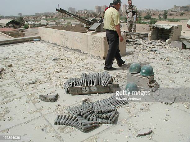 Army Major and Army civilian volunteers of Forward Engineer Support TeamAdvanced examine condition of the Baghdad Train Station as part of their...