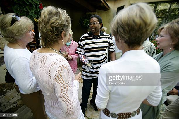 Army Major Anthony L Smith a veteran amputee wounded in the Iraq conflict speaks to ladies who are attending an awareness raising event August 14...