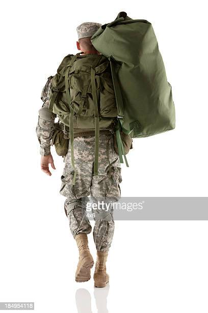 Army man carrying a luggage