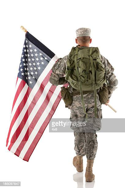 Army man carrying an American flag
