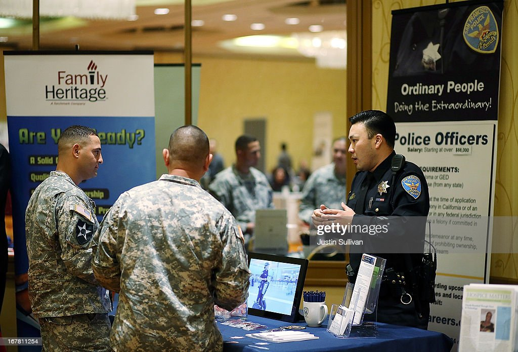 U.S. Army Master Sgt. Yeffiry Disla (L) meets with a recruiter from the San Francisco police department during the 'Hiring Our Heroes' job fair on April 30, 2013 in Walnut Creek, California. Seventy-five active duty members of the military and veterans registered to attend the 'Hiring Our Heroes' job fair hosted by the U.S. Department of Commerce. Hundreds of 'Hiring Our Heroes' events are being held across the country in 2013 in the hopes of having a half million military veterans employed by the end of 2014.