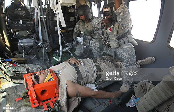 S Army MEDEVAC helicopter crew chief SPC David Doll from Dallas TX and flight medic SSG Rahkeem Francis with Dustoff Task Force Shadow of the 101st...
