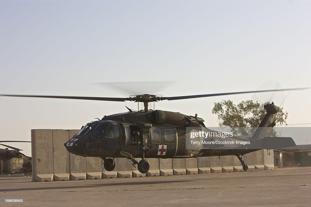 A U.S. Army medevac UH-60 Black Hawk helicopter takes off from COB Speicher, Tikrit, Iraq.