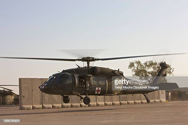 A U.S. Army medevac UH-60 Black Hawk helicopter takes off from COB Speicher, Tikrit, Iraq.