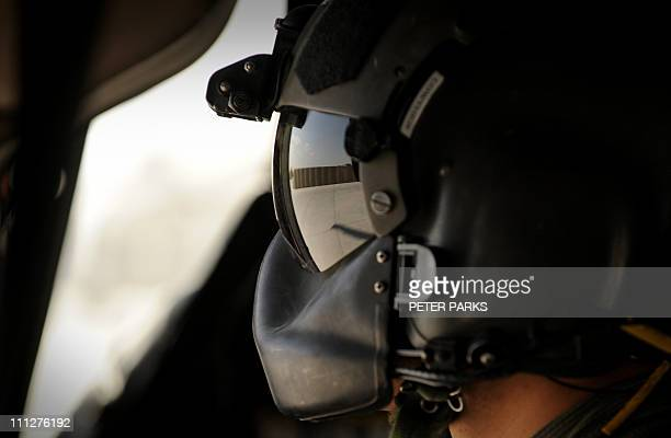 US army medic Sergaent Brandon Lowther prepares to fly a mission in a Blackhawk helicopter from Company C 1st Battalion 52nd Aviation Regiment...