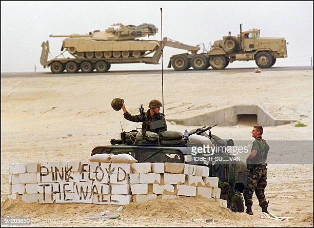 US Army Military Police sit at their check point along a convoy route 20 January 1991 somewhere in Saudi desert The MP's said they wrote the name of...
