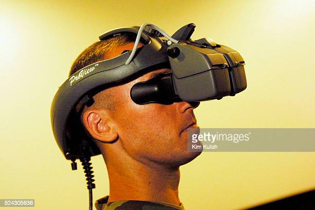 Army MSG William Filpkowski demonstrates the stereo Head Mounted Display Several virtual reality projects are under development for the United States...