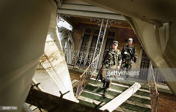 Army National Guard conduct search operations in the Ninth Ward September 12 2005 in New Orleans Louisiana Rescue efforts and clean up continue in...
