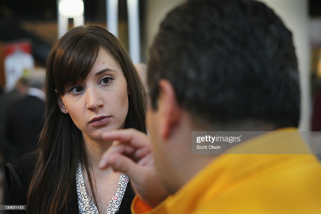 Army National Guard veteran Amanda Luzzi speaks with Caterpillar recruiter Tony Alvarado at the Hiring our Heroes job fair on October 27 2011 in...