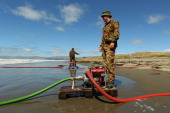 Army officer continue to pump seawater at New Brighton Beach where they are operating a mobile desalination and water purification station providing...