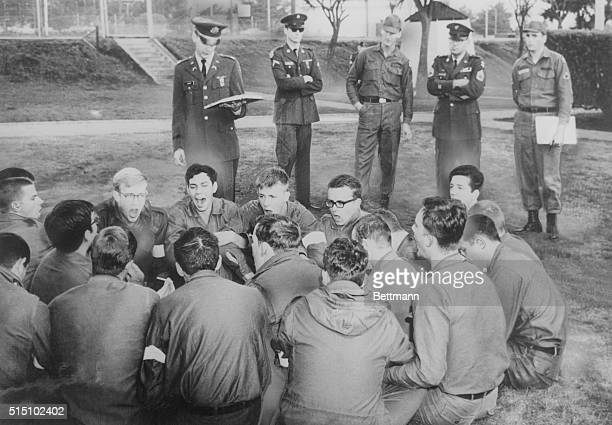 Army officers reading the mutiny act to soldiers engaged in a sit in and singing 'We Shall Overcome' at the Presidio stockade in San Francisco...
