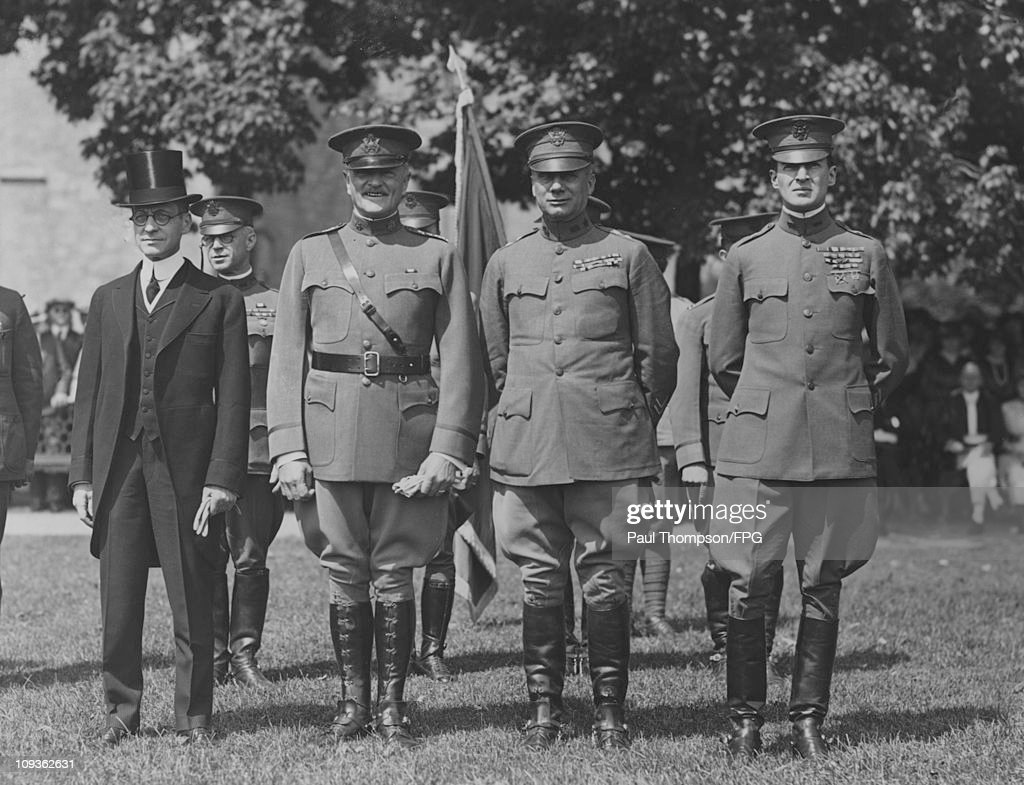 US Army officers review the cadets during a graduation at West Point Military Academy, New York State, circa 1920. From left to right, Secretary of War Newton D. Baker, General John J. Pershing, General William M. Wright and Brigadier General Douglas MacArthur.