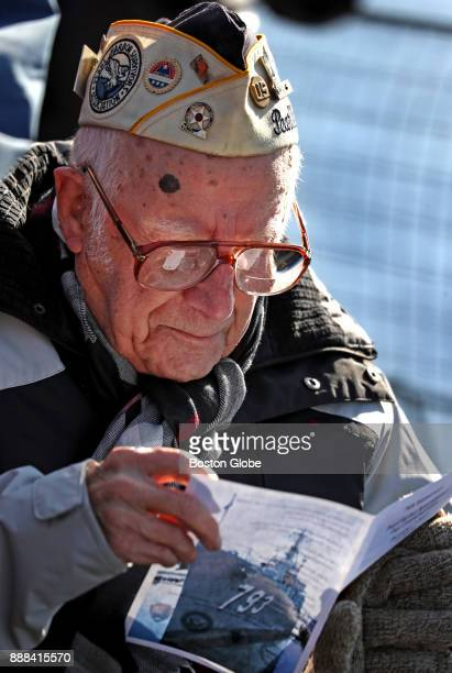 S Army Pearl Harbor survivor Emery Arsenault of Peabody MA reads over the program for a ceremony commemorating the 76th anniversary of the attack on...