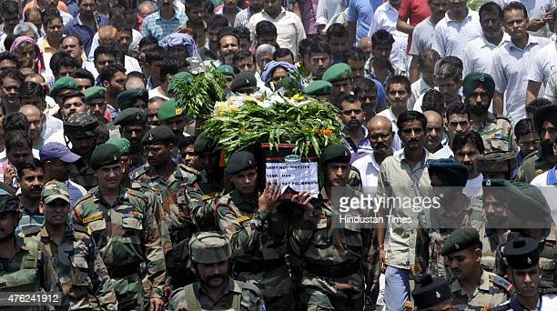 Army personnel carry the coffin of Havaldars Satpal Bhasin who was killed in Ambush in Manipur during his funeral procession at Muthi village in the...