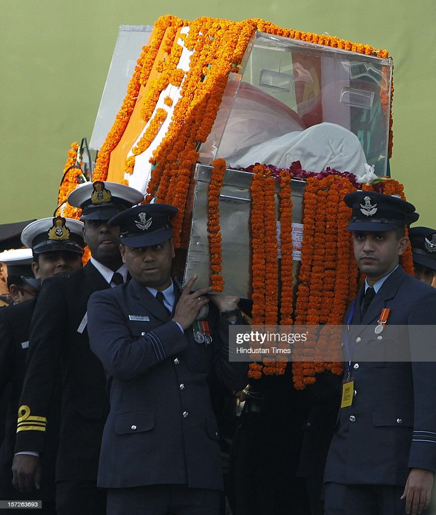 Army personnel carrying the mortal remains of former Prime Minister of India Inder Kumar Gujral during his funeral on December 1, 2012 in New Delhi, India. Inder Kumar Gujral who served as 12th Prime minister of India from April 1997 to March 1998 passed away on November 30, 2012 at the age of 92 years.