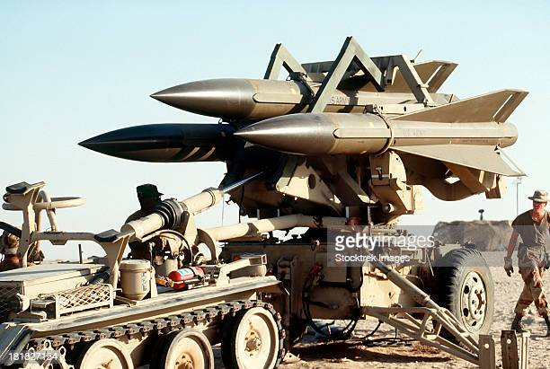 U.S. Army personnel deploy an MIM-23B Hawk surface-to-air missile system in the desert during Operation Desert Shield.