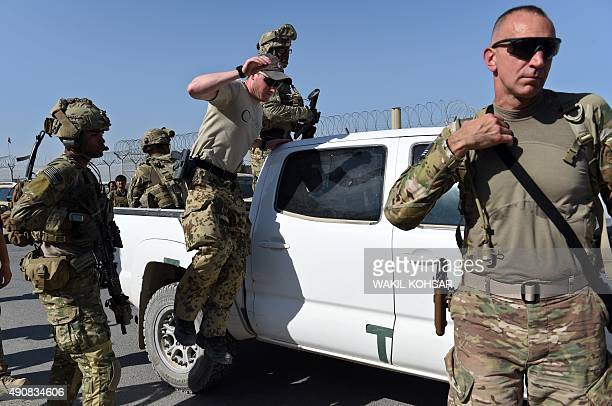 US army personnel leave a truck inside an Afghan military base during fighting between Taliban militants and Afghan security forces in Kunduz on...