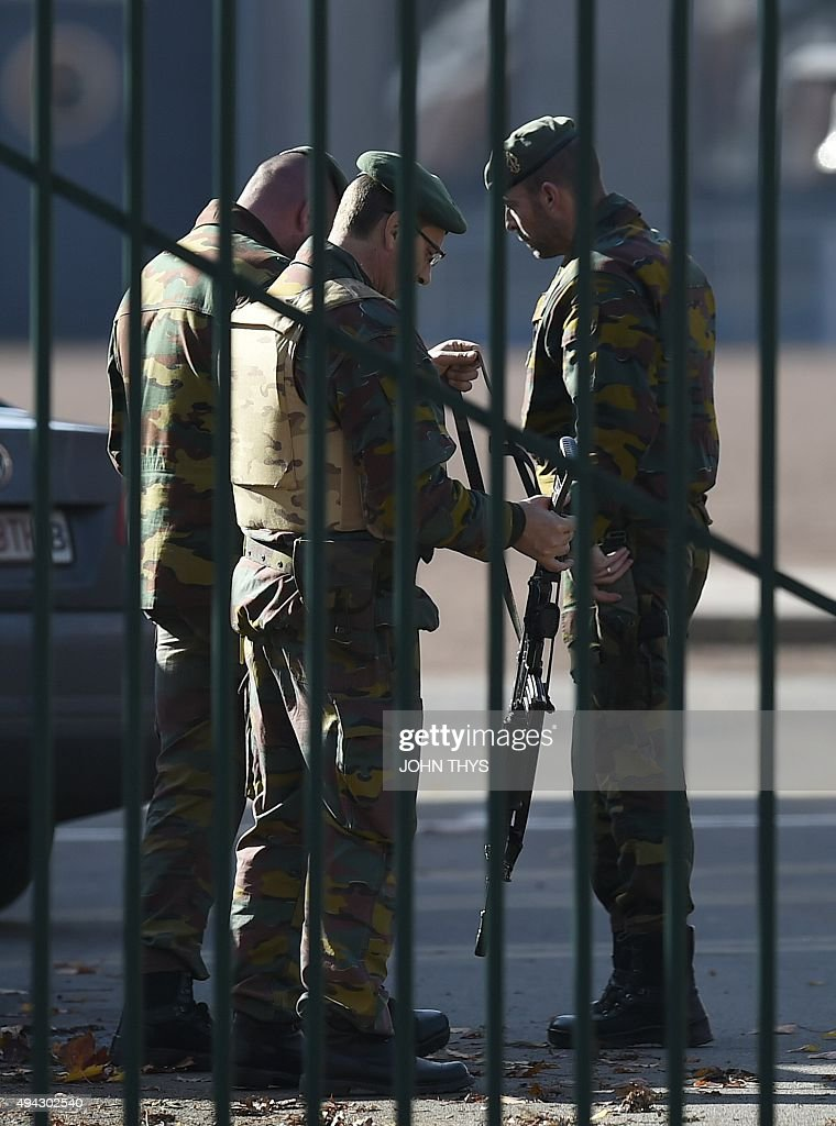 Army personnel patrol at the site where a man allegedly drove his car into the gates of a military barracks in Flawinne Namur Province on October 26...