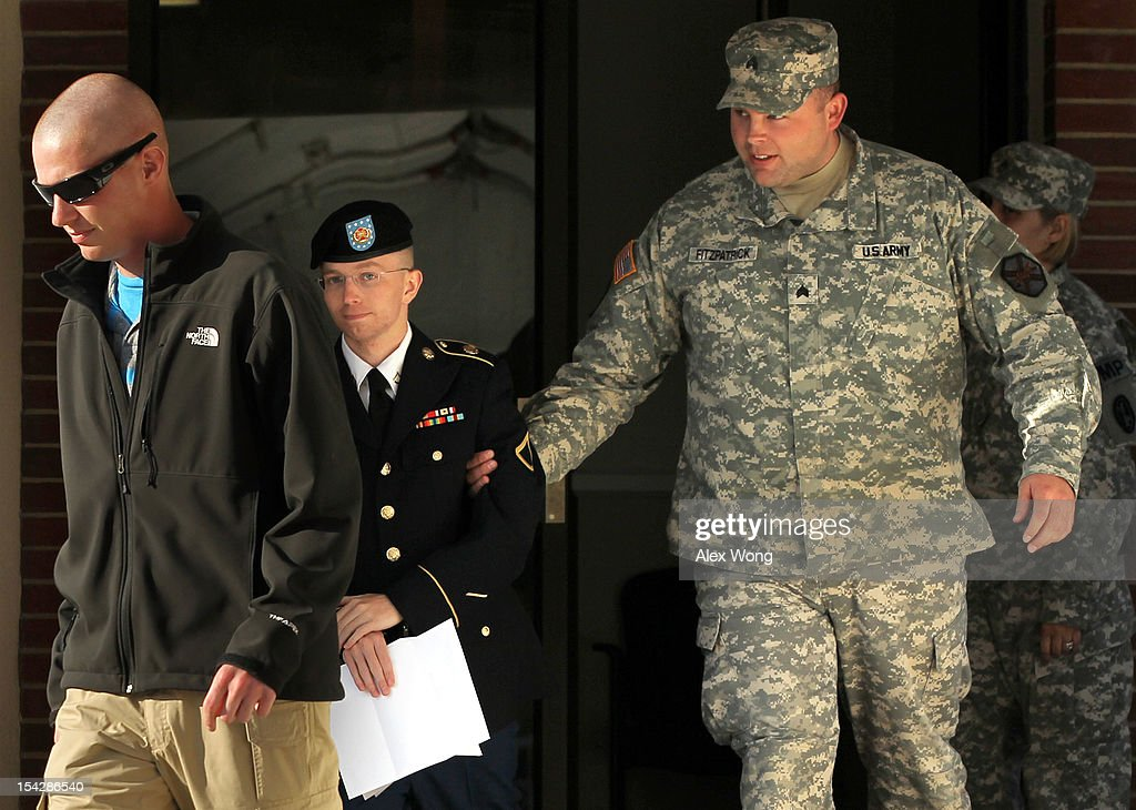 U.S. Army Pfc. Bradley Manning (C) is escorted away after a hearing on the witness list of a speedy trial motion October 17, 2012 at Fort Meade in Maryland. Manning is charged with aiding the enemy and transmitting defense records, plus other counts, after he was accused of passing classified documents to the whistleblower website WikiLeaks.
