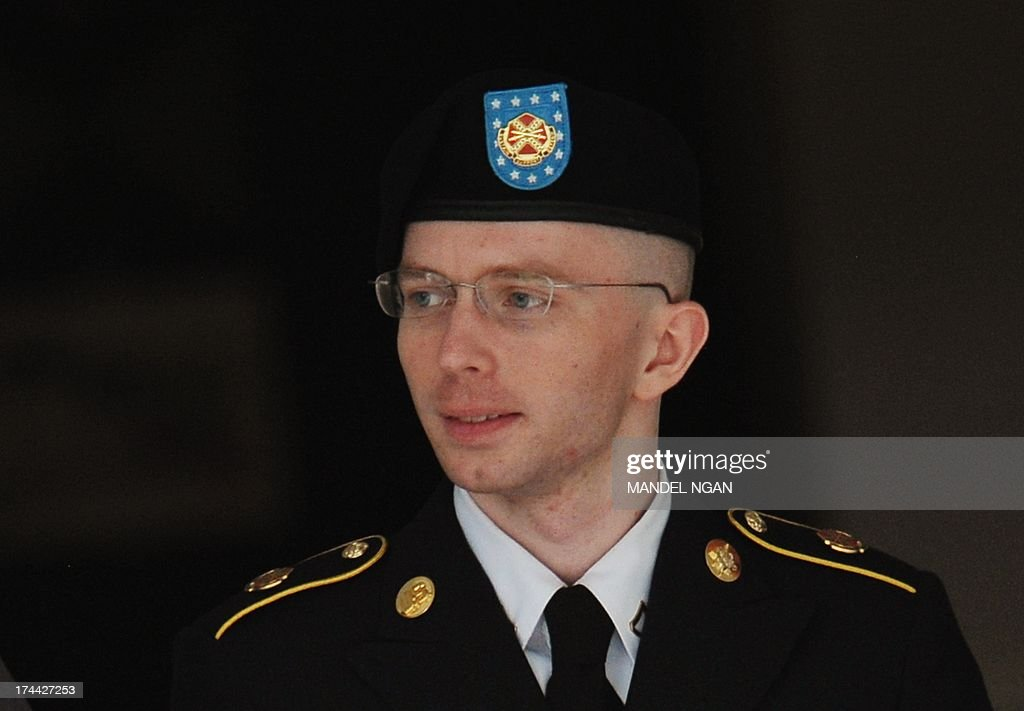 Army Pfc. Bradley Manning is escorted from court on July 25, 2013 in Fort Meade, Maryland on July 25, 2013. The trial of Manning, accused of 'aiding the enemy' by giving secret documents to WikiLeaks, is entering its final stage Thursday as both sides present closing arguments. AFP PHOTO/Mandel NGAN