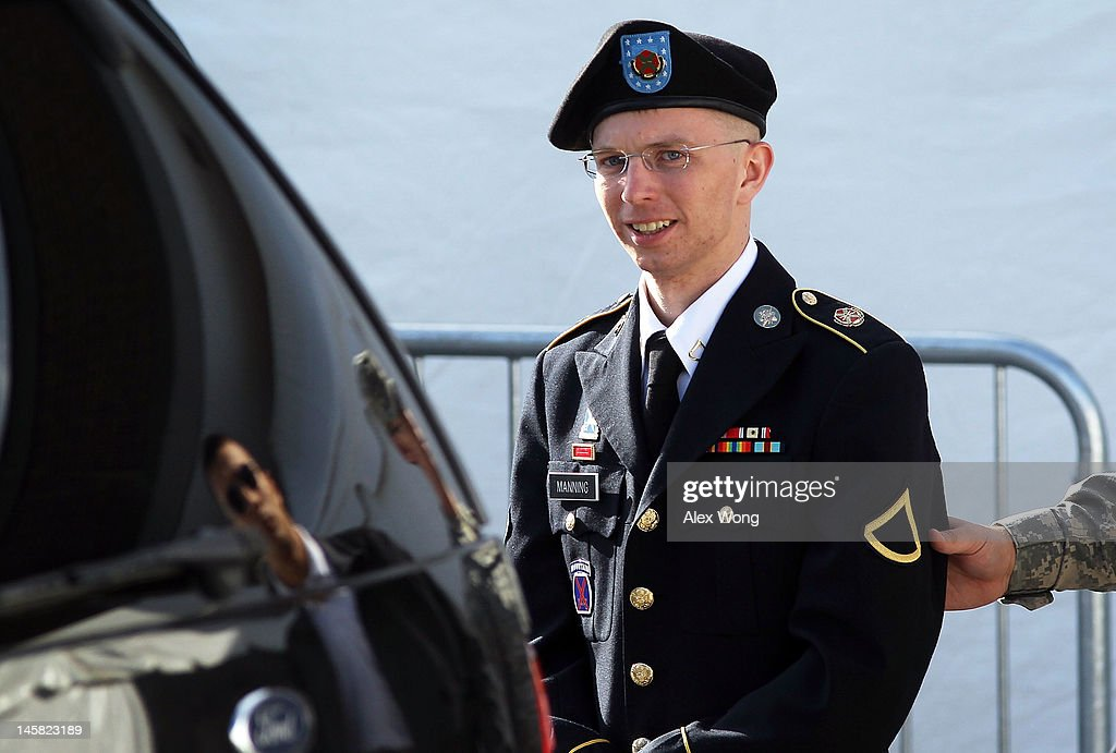 U.S. Army Private Bradley Manning is escorted as he leaves a military court at the end of the first of a three-day motion hearing June 6, 2012 in Fort Meade, Maryland. Manning, an Army intelligence analyst who has been accused of passing thousands of diplomatic cables and intelligence reports to the whistleblowing website WikiLeaks and facing 22 charges including aiding the enemy, returned to the court room to ask for dismissal of 10 of the charges.