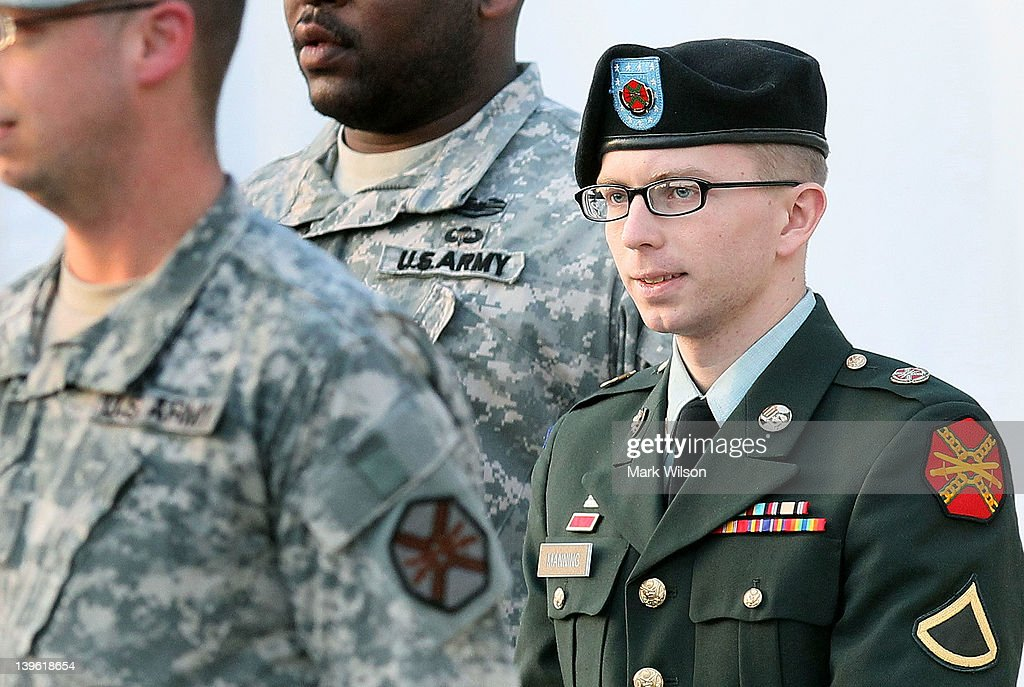 Army Private Bradley Manning is escorted away from his Article 32 hearing February 23, 2012 in Fort Meade, Maryland. During the hearing, Manning deferred his plea to the 22 charges against him and deferred a decision over whether he wanted a military judge or a jury to hear his case.