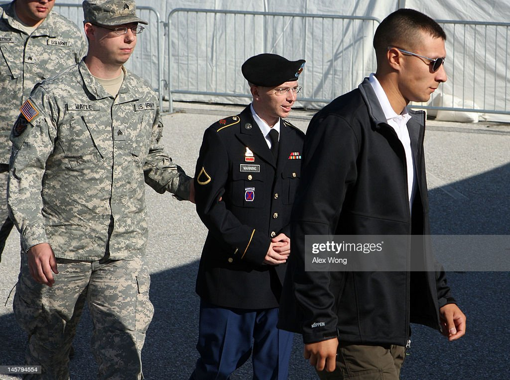 U.S. Army Private Bradley Manning (2nd R) is escorted during his arrival to military court on the first day of a three-day motion hearing June 6, 2012 in Fort Meade, Maryland. Manning, an Army intelligence analyst, has been accused of passing thousands of diplomatic cables and intelligence reports to the whistleblowing website WikiLeaks and faces 22 charges, including aiding the enemy. Manning returned to court to ask for a dismissal of 10 of the charges.