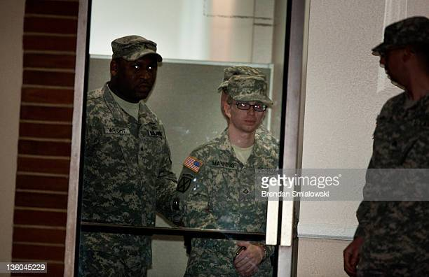 Army Private Bradley Manning is escorted out after the second day of an Article 32 hearing December 17 2011 in Fort Meade Maryland An Article 32...