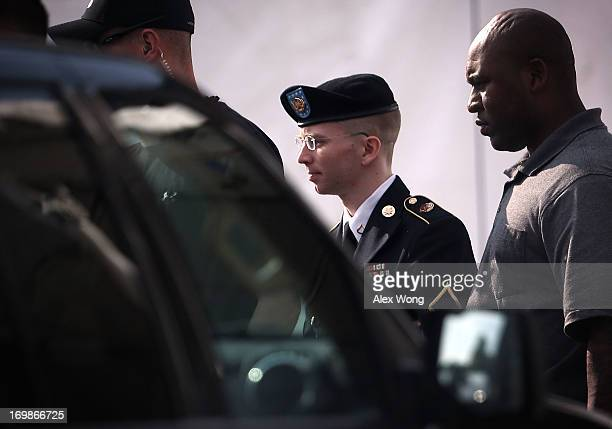S Army Private First Class Bradley Manning is escorted as he leaves a military court for the day June 3 2013 at Fort Meade in Maryland Manning was...