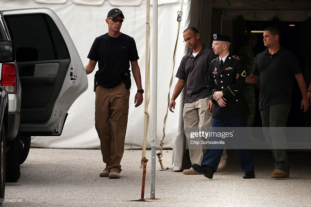 U.S. Army Private First Class <a gi-track='captionPersonalityLinkClicked' href=/galleries/search?phrase=Bradley+Manning&family=editorial&specificpeople=7643431 ng-click='$event.stopPropagation()'>Bradley Manning</a> (3rd L) is escorted by military police as he leaves after the first day of closing arguments in his military trial July 25, 2013 Fort George G. Meade, Maryland. Manning, who is charged with aiding the enemy and wrongfully causing intelligence to be published on the internet, is accused of sending hundreds of thousands of classified Iraq and Afghanistan war logs and more than 250,000 diplomatic cables to the website WikiLeaks while he was working as an intelligence analyst in Baghdad in 2009 and 2010.