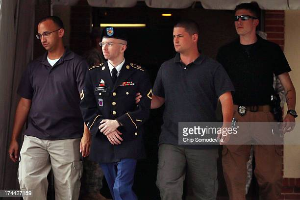 S Army Private First Class Bradley Manning is escorted by military police as he leaves after the first day of closing arguments in his military trial...