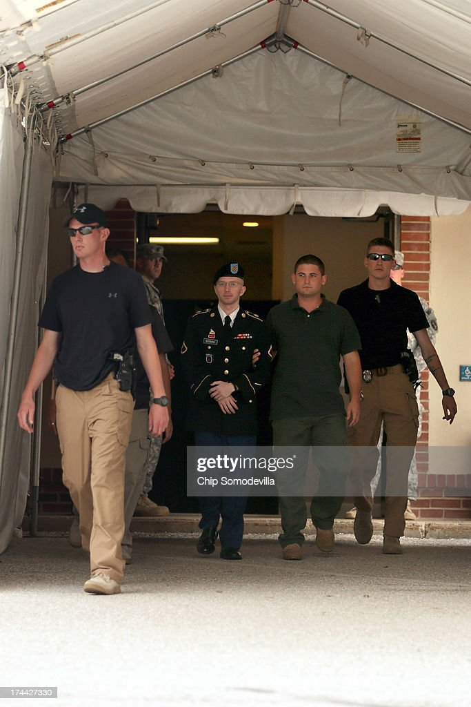 U.S. Army Private First Class <a gi-track='captionPersonalityLinkClicked' href=/galleries/search?phrase=Bradley+Manning&family=editorial&specificpeople=7643431 ng-click='$event.stopPropagation()'>Bradley Manning</a> (2nd L) is escorted by military police as he leaves after the first day of closing arguments in his military trial July 25, 2013 Fort George G. Meade, Maryland. Manning, who is charged with aiding the enemy and wrongfully causing intelligence to be published on the internet, is accused of sending hundreds of thousands of classified Iraq and Afghanistan war logs and more than 250,000 diplomatic cables to the website WikiLeaks while he was working as an intelligence analyst in Baghdad in 2009 and 2010.