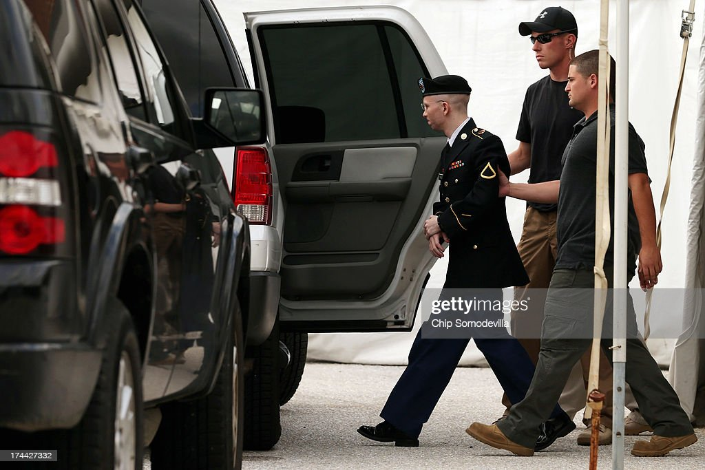 U.S. Army Private First Class <a gi-track='captionPersonalityLinkClicked' href=/galleries/search?phrase=Bradley+Manning&family=editorial&specificpeople=7643431 ng-click='$event.stopPropagation()'>Bradley Manning</a> (L) is escorted by military police as he leaves after the first day of closing arguments in his military trial July 25, 2013 Fort George G. Meade, Maryland. Manning, who is charged with aiding the enemy and wrongfully causing intelligence to be published on the internet, is accused of sending hundreds of thousands of classified Iraq and Afghanistan war logs and more than 250,000 diplomatic cables to the website WikiLeaks while he was working as an intelligence analyst in Baghdad in 2009 and 2010.