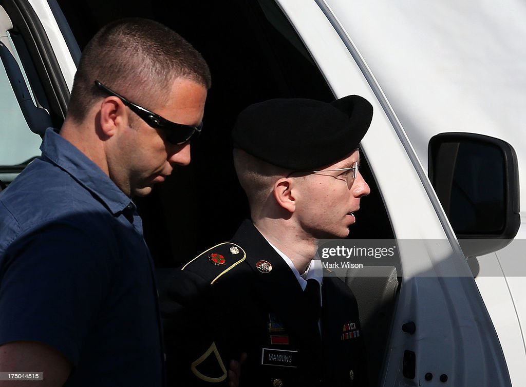 U.S. Army Private First Class <a gi-track='captionPersonalityLinkClicked' href=/galleries/search?phrase=Bradley+Manning&family=editorial&specificpeople=7643431 ng-click='$event.stopPropagation()'>Bradley Manning</a> (R) is escorted by military police as arrives to hear the verdict in his military trial July 30, 2013 at Fort George G. Meade, Maryland. Manning, who is charged with aiding the enemy and wrongfully causing intelligence to be published on the internet, is accused of sending hundreds of thousands of classified Iraq and Afghanistan war logs and more than 250,000 diplomatic cables to the website WikiLeaks while he was working as an intelligence analyst in Baghdad in 2009 and 2010.