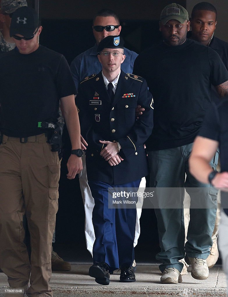 U.S. Army Private First Class <a gi-track='captionPersonalityLinkClicked' href=/galleries/search?phrase=Bradley+Manning&family=editorial&specificpeople=7643431 ng-click='$event.stopPropagation()'>Bradley Manning</a> is escorted by military police as he leaves his military trial after he was found guilty of 20 out of 21 charges, July 30, 2013 Fort George G. Meade, Maryland. Manning, was found not guilty of aiding the enemy, was convicted of wrongfully causing intelligence to be published on the internet, is accused of sending hundreds of thousands of classified Iraq and Afghanistan war logs and more than 250,000 diplomatic cables to the website WikiLeaks while he was working as an intelligence analyst in Baghdad in 2009 and 2010.