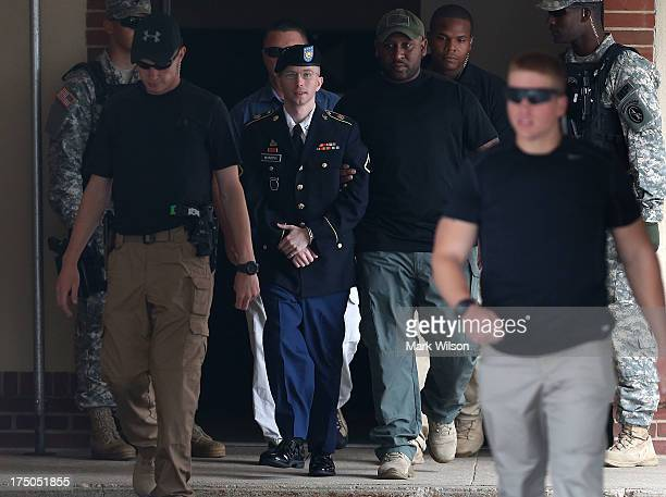 S Army Private First Class Bradley Manning is escorted by military police as he leaves his military trial after he was found guilty of 20 out of 21...