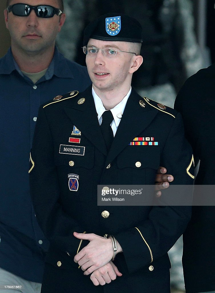 U.S. Army Private First Class Bradley Manning is escorted by military police as he leaves his military trial after he was found guilty of 20 out of 21 charges, July 30, 2013 Fort George G. Meade, Maryland. Manning, was found not guilty of aiding the enemy, was convicted of wrongfully causing intelligence to be published on the internet, is accused of sending hundreds of thousands of classified Iraq and Afghanistan war logs and more than 250,000 diplomatic cables to the website WikiLeaks while he was working as an intelligence analyst in Baghdad in 2009 and 2010.