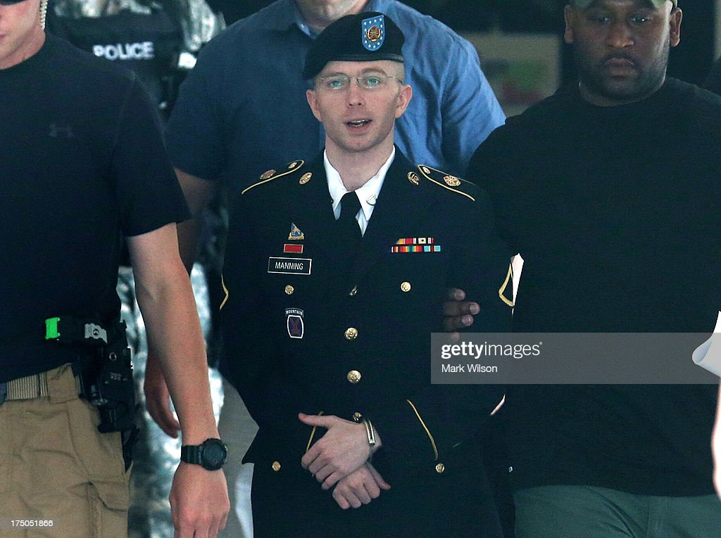 U.S. Army Private First Class <a gi-track='captionPersonalityLinkClicked' href=/galleries/search?phrase=Bradley+Manning&family=editorial&specificpeople=7643431 ng-click='$event.stopPropagation()'>Bradley Manning</a> (C) is escorted by military police as he leaves his military trial after he was found guilty of 20 out of 21 charges, July 30, 2013 Fort George G. Meade, Maryland. Manning, was found not guilty of aiding the enemy, was convicted of wrongfully causing intelligence to be published on the internet, is accused of sending hundreds of thousands of classified Iraq and Afghanistan war logs and more than 250,000 diplomatic cables to the website WikiLeaks while he was working as an intelligence analyst in Baghdad in 2009 and 2010.
