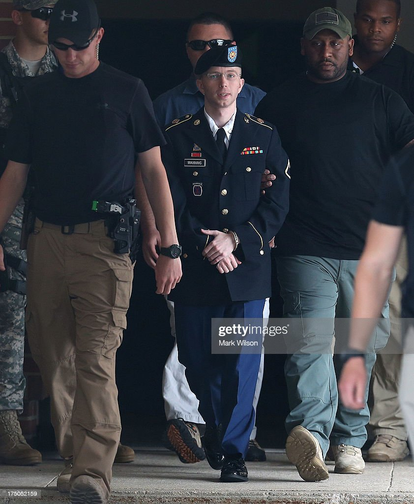 U.S. Army Private First Class Bradley Manning is escorted by military police as he leaves his military trial after he was found guilty of 20 out of 21 charges, July 30, 2013 at Fort George G. Meade, Maryland. Manning, was found not guilty of aiding the enemy, was convicted of wrongfully causing intelligence to be published on the internet, is accused of sending hundreds of thousands of classified Iraq and Afghanistan war logs and more than 250,000 diplomatic cables to the website WikiLeaks while he was working as an intelligence analyst in Baghdad in 2009 and 2010.