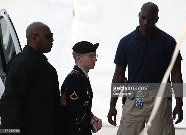 Army Private First Class Bradley Manning is escorted by military police as he arrives for his sentencing at military court facility for the...