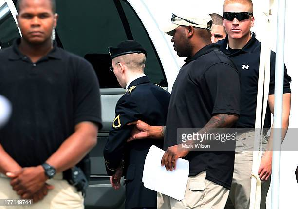 S Army Private First Class Bradley Manning is escorted by military police after he was sentenced to 35 years in prison August 21 2013 in Fort Meade...