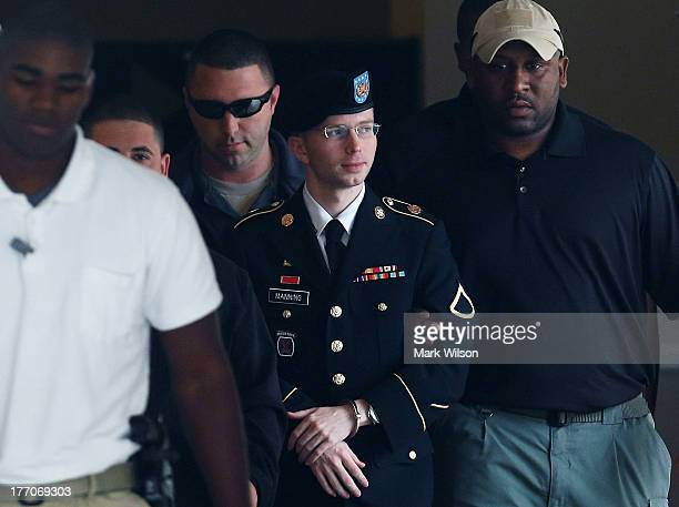 Army Private First Class Bradley Manning is escorted out of a military court facility during the sentencing phase of his trial August 20 2013 in Fort...