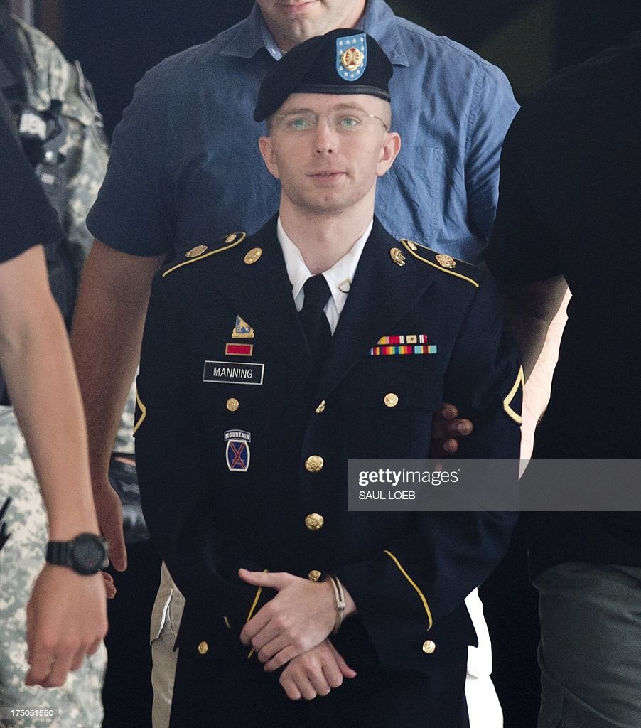 US Army Private First Class Bradley Manning leaves a military court facility after hearing his verdict in the trial at Fort Meade, Maryland on July 30, 2013. Manning has been acquitted of aiding the enemy when he shared classified documents on US military actions in Iraq and Afghanistan with WikiLeaks, but he was convicted of lesser charges, including espionage. Military Judge Col. Denise Lind issued her verdict early Tuesday afternoon. She found Manning guilty of five espionage counts, five theft charges, a computer fraud charge and other military infractions. The aiding the enemy charge was the most severe and carried the possibility of life in prison. Manning, though, isn't likely to avoid prison time. His sentence hearing will begin on July 31, 2013. AFP PHOTO / Saul LOEB