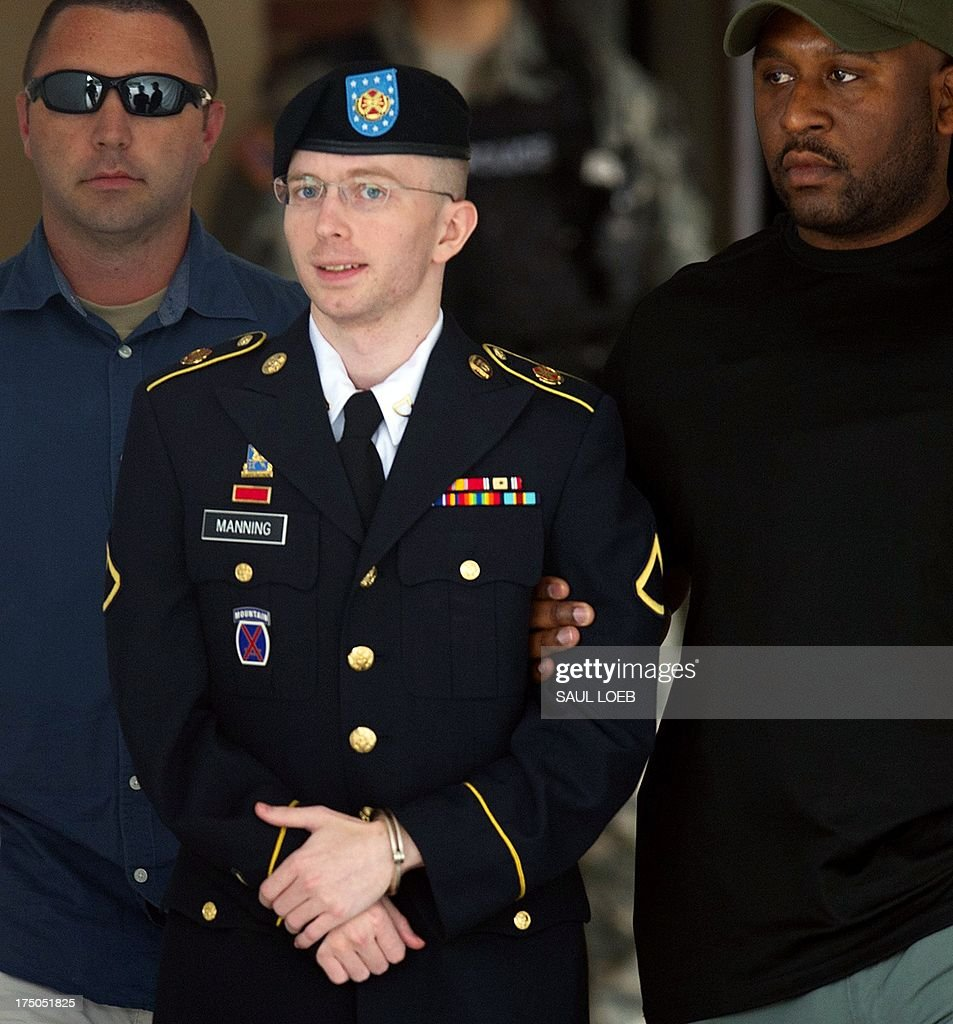 US Army Private First Class Bradley Manning leaves a military court facility after hearing his verdict in the trial at Fort Meade, Maryland on July 30, 2013. A US military judge convicted Bradley Manning of espionage Tuesday, leaving him facing a lengthy jail term despite clearing him on the most serious charge that he 'aided the enemy.' Colonel Denise Lind found Manning guilty of 20 of 22 counts related to his leaking of a huge trove of secret US diplomatic cables and military logs to the WikiLeaks website. She said she would begin sentencing hearings on Wednesday, at the Fort Meade military base outside Washington where the trial was held. If Lind decides to impose penalties in the higher ranges permitted under the charges, the now 25-year-old Manning could face a de facto life sentence of more than 100 years in jail. AFP PHOTO / Saul LOEB