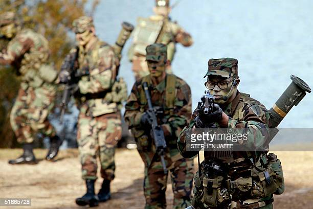 Army Rangers demonstrate their patroling at the Ranger Training Bridgade at the US Army Infantry School in Fort Benning Georgia 20 December 2002 The...